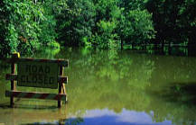 Water flooding with &#34Road Closed&#34 sign